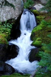 Beautiful cascading water fall on public speaker, workshop leader page