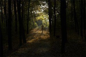"""Woman walking towards light on """"Depression Treatment"""" page"""